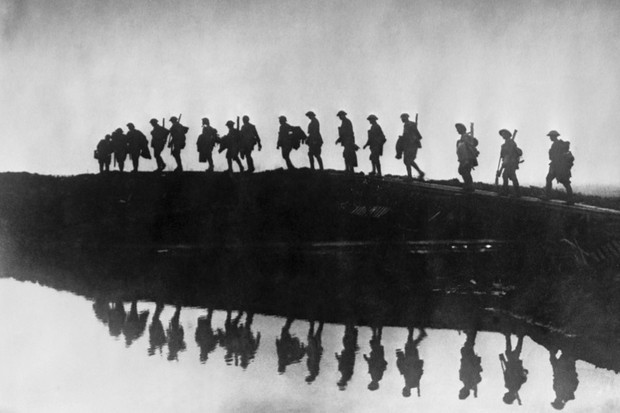 Supporting troops of the 1st Australian Division walking on a duckboard track near Hooge, in the Ypres Sector, 5 October 1917. (Photo by Frank Hurley/Hulton Archive/Getty Images)