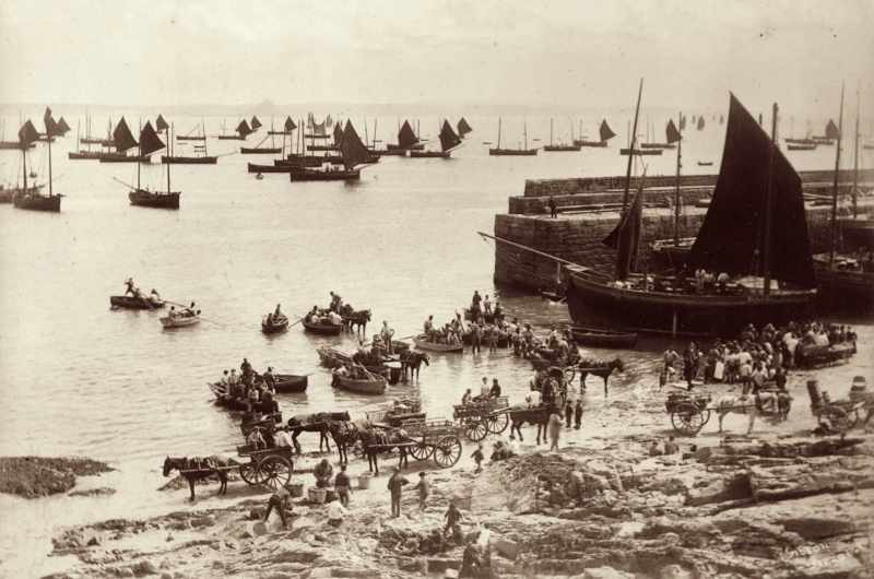 The daily hustle and bustle in the busy fishing port of Newlyn in Penzance, Cornwall, c1870. (Photo by Gibson/Hulton Archive/Getty Images)