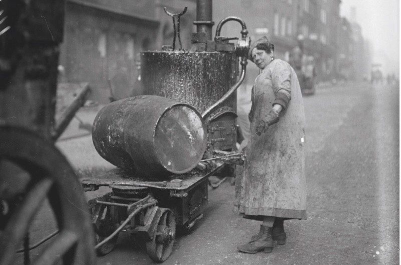 Hard labour: a woman tarring and flinting in Oxford Street, central London, 1919. (Getty Images)