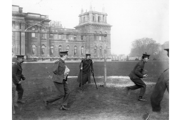 Wounded soldiers playing football outside Blenheim Palace, c1916. (Photo by Central Press/Getty Images)