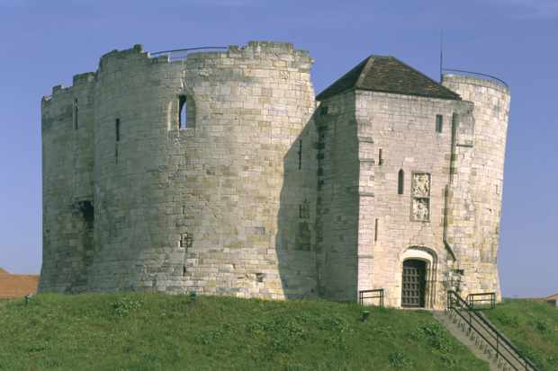 Clifford's Tower, York, North Yorkshire, 1997. Clifford's Tower is the keep of the former York castle. The present stone keep was built on the man-made earth motte in the early 14th century, and due to subsidence it cracked in two places. (Photo by English Heritage/Heritage Images/Getty Images)