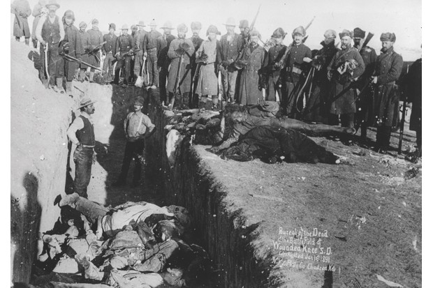 The dead are buried at Wounded Knee Creek in South Dakota. Women and children were among those killed in the 1890 massacre. (Getty Images)