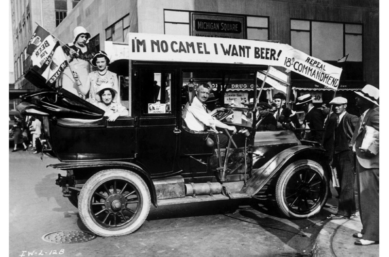 Prohibition protesters parade in a car emblazoned with signs and flags calling for the repeal of the 18th Amendment, which outlawed the production and consumption of alcohol in the United States. (Archive Photos/Getty Images)