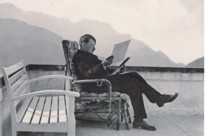 GERMANY - JANUARY 01:  The Berghof of Adolf Hitler at the Obersalzberg near Berchtesgaden: Adolf Hitler at the patio of the Berghof,  wearing civil clothes, sitting in a basket-chair and reading files. Photography, around 1936.  (Photo by Imagno/Getty Images) [Der Berghof von Adolf Hitler am Obersalzberg bei Berchtesgaden: Adolf Hitler in Zivil, auf der Terrasse des Berghofs in einem Korbsessel sitzend und Akten lesend. Photographie, um 1936.]