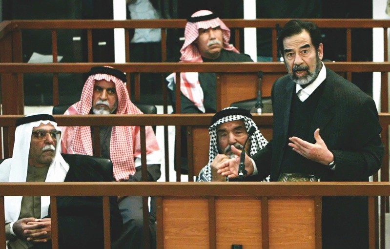 Saddam Hussein speaks at his trial in Baghdad in March 2006. (© Getty Images)