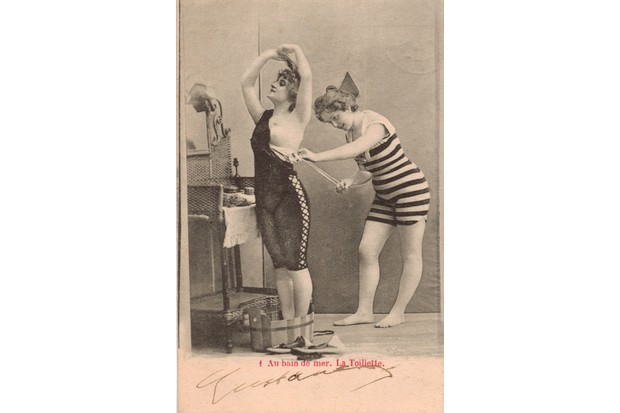 Two women photographed as if preparing for a swim
