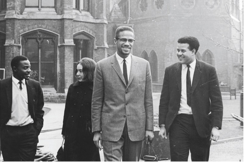 "Malcolm X chats with Eric Abrahams – the Oxford Union president who vowed to ""fill the room with blacks"" – before giving his famous address on 3 December 1964. (Getty)"
