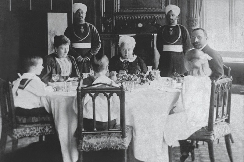 SZP809266 Queen Victoria with her son Edward VII and family (b/w photo) by German Photographer, (19th century); (add.info.: Victoria (1819-1901), Queen of Great Britain and Ireland (1835-1901) and Empress of India (1876-1901), who is sitting here with her son Edward VII and his family at the table. ); © SZ Photo / Knorr & Hirth; German,  out of copyright