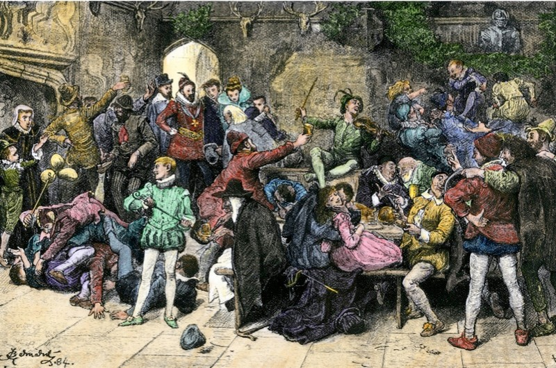Christmas merriment in an old English manor in the 1500s. (Photo by North Wind Picture Archives/Alamy)