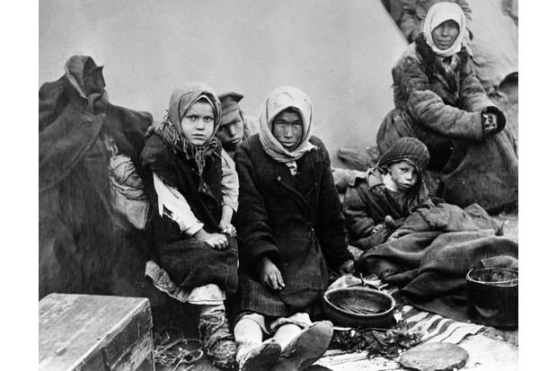 A starving family in the Volga area, pictured during the famine that afflicted the area over the winter of 1921/22, caused in part by the economic and logistic effects of the Russian Revolution. (Getty Images)