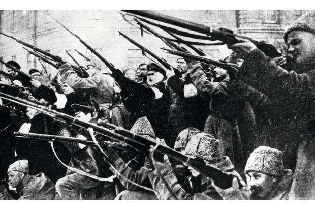 A photo (possibly staged) shows Bolsheviks storming the Winter Palace in Petrograd, ejecting the cabinet of the provisional Russian government. (Getty Images)