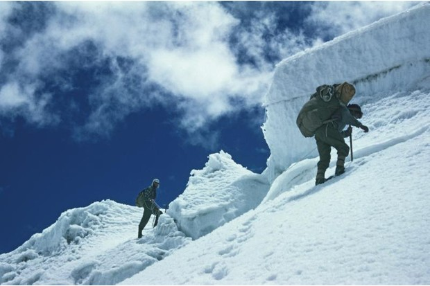 A photograph of photographer George Lowe and Cho Oyu mountain