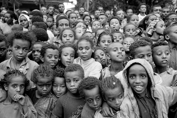 Ethiopian children watching a play