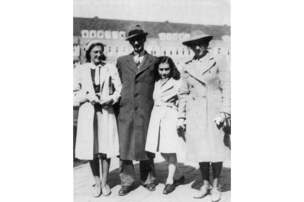 Anne Frank, second from right, with her sister Margot, father Otto and mother Edith, in the Merwedeplein, Amsterdam, 1941. (Photo by Granger, NYC/Alamy Stock Photo)