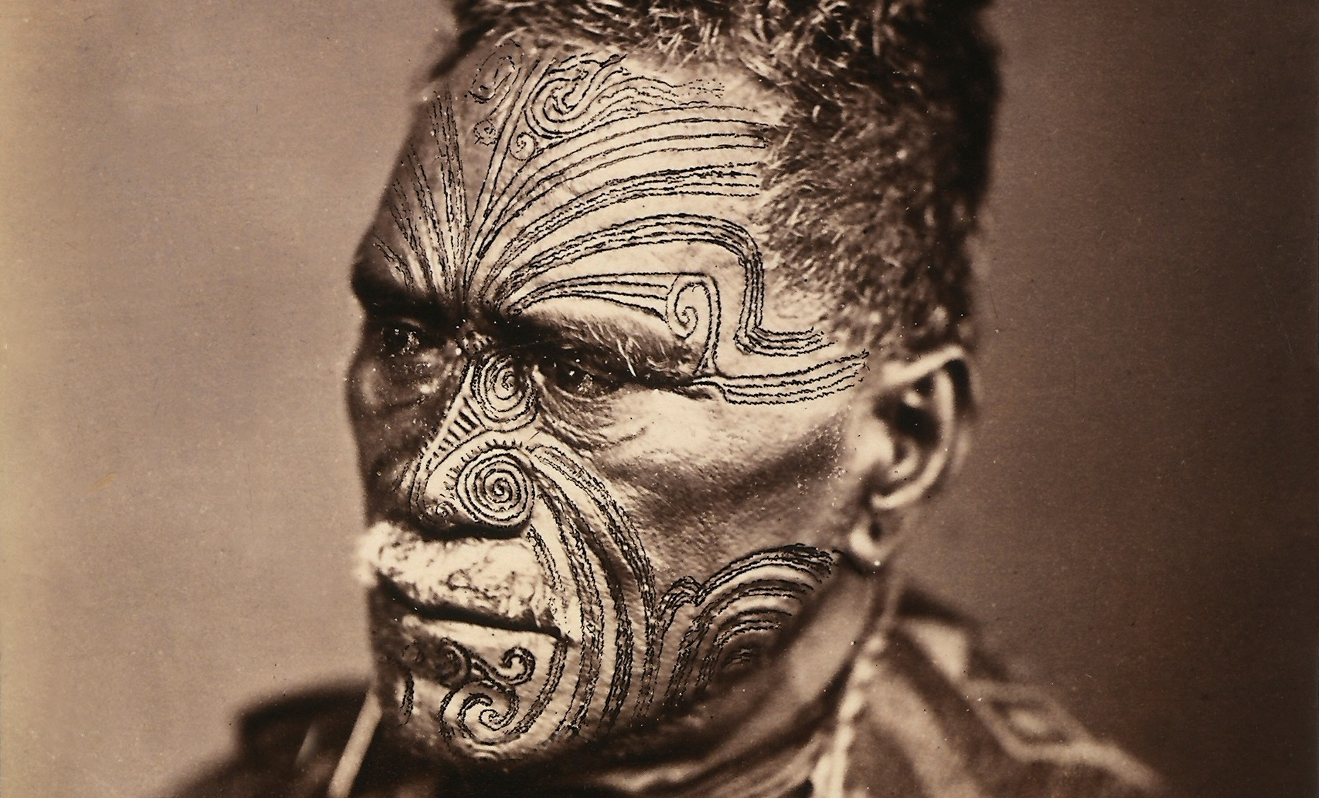 Portrait of a Maori with tattooed face
