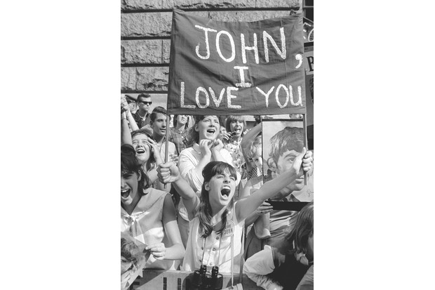 Fans in New York. Their frenzied behaviour made it difficult for the Beatles to get from venue to venue. Some US critics linked the band with Communism, or feared its influence would lead young people to riot. (Alamy)
