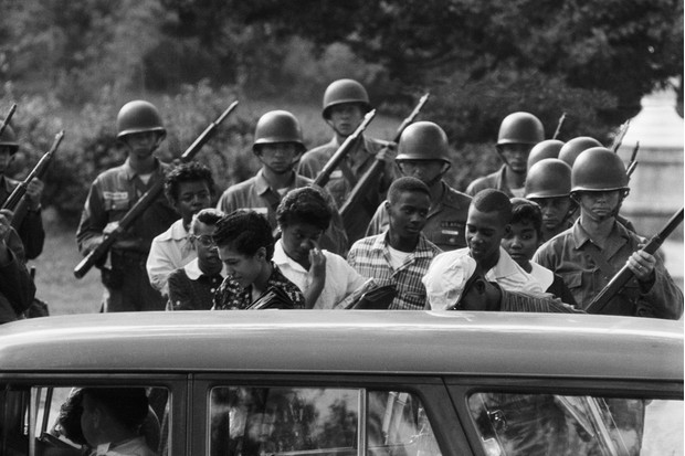Soldiers guard black students leaving Little Rock school, 1957. (Corbis)
