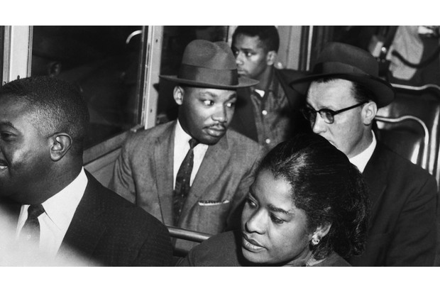 Martin Luther King, Jr rides the Montgomery bus with Reverend Glenn Smiley of Texas in 1956. (Corbis)