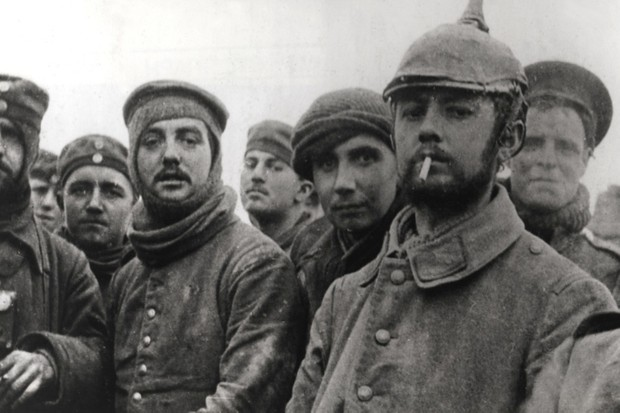British from the 11th Brigade 4th division and German soldiers at Ploegsteert in Belgium on Christmas Day 1914. (Photo by The Art Archive/Alamy)