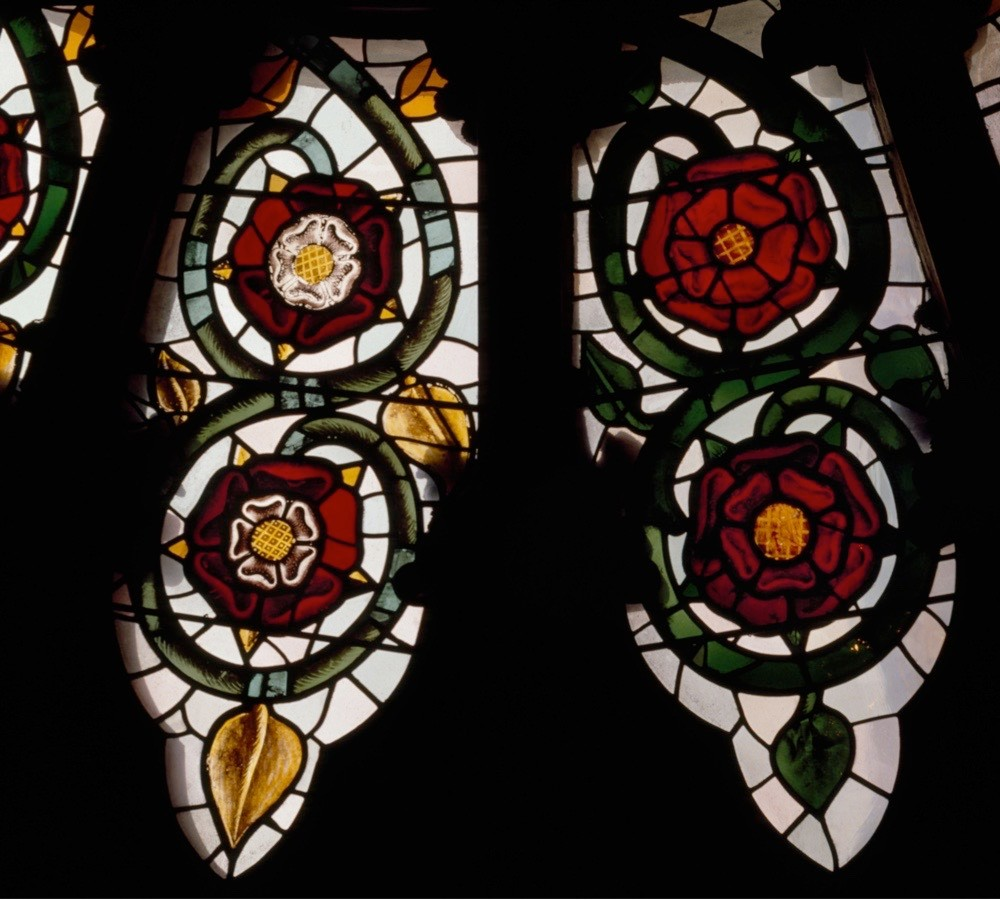 "York Minster's south transept rose window features 16th-century Tudor Roses white on red (left) and Lancastrian Roses, red. The Tudor Rose became known as ""the flower of England"" and is today England's national flower. (Angelo Hornak/Alamy Stock Photo)"