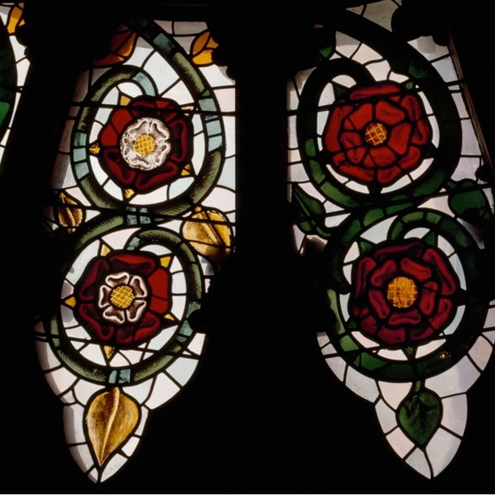 """York Minster's south transept rose window features 16th-century Tudor Roses white on red (left) and Lancastrian Roses, red. The Tudor Rose became known as """"the flower of England"""" and is today England's national flower. (Angelo Hornak/Alamy Stock Photo)"""
