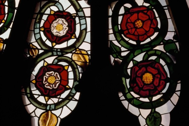York Minster's rose window features 16th-century Tudor Roses white on red (left) and Lancastrian Roses, red