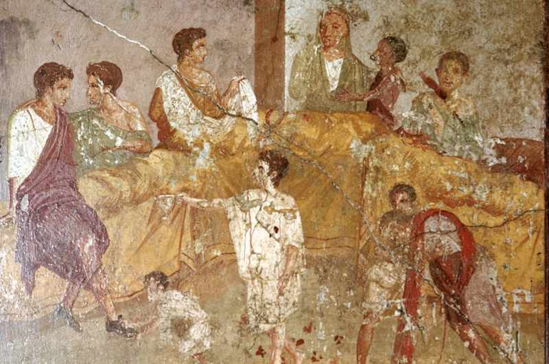 Roman wallpainting of a dinner party, Pompeii, Italy. (Photo by Heritage Image Partnership Ltd/Alamy)