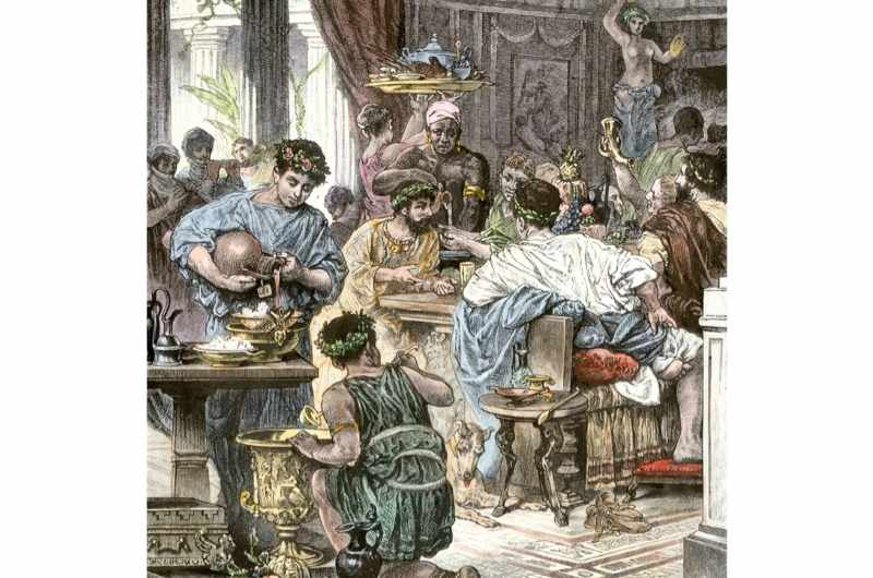 Banquet at a wealthy home in ancient Rome. (Photo by North Wind Picture Archives/Alamy)