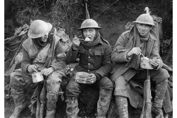 British soldiers eating hot rations in the Ancre Valley during the battle of the Somme, October 1916. Ministry of Information First World War Official Collection. (Photo by Lt E Brooks/ IWM via Getty Images)