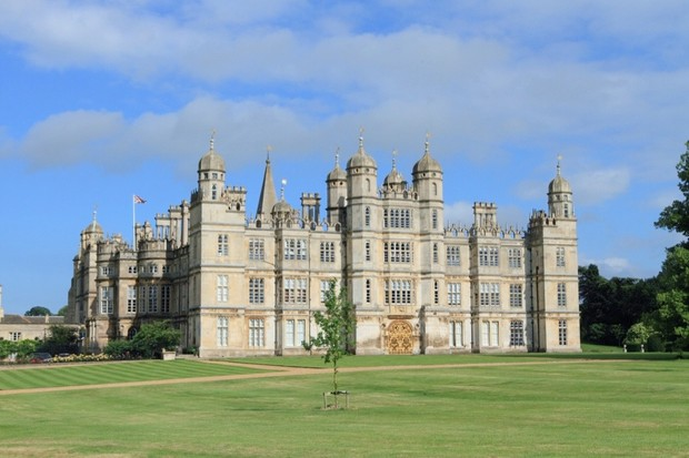 Photograph of Burghley House and its surrounding grounds.