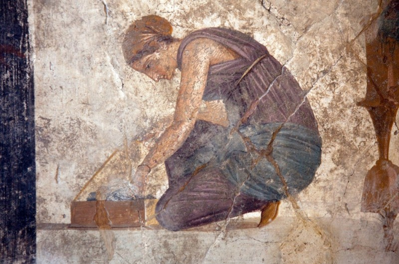 A Pompeii mural depicting a slave, in the Naples Museum. (Photo by Sites & Photos/Capture Ltd/ Alamy Stock Photo)