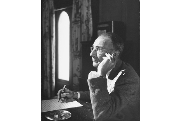 CS Forester smoking a cigar while working. It was Forester who encouraged Dahl to write about his experiences in Libya during the Second World War. (Photo by Ralph Crane/The LIFE Images Collection/Getty Images)