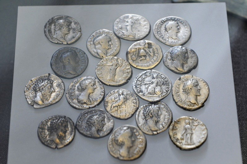 Roman silver denarius coins AD 72 till 200 and were offered up at the beginning of the 4th century AD, from the Nydan Bog archaeological site. (Photo by Clare Rowan)