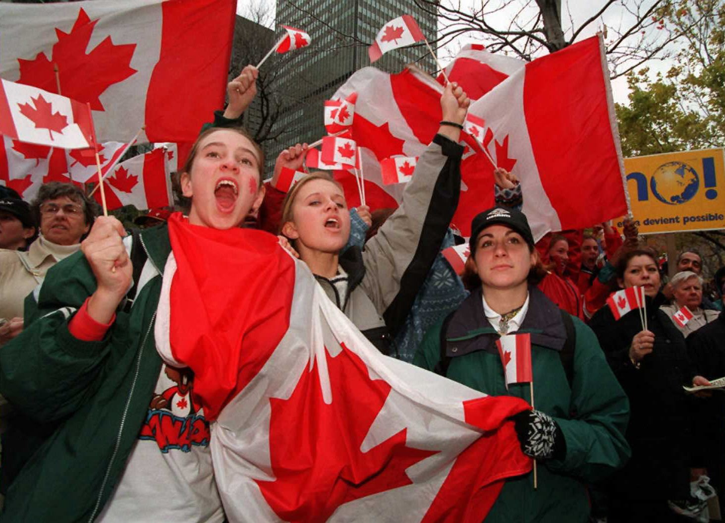 Montreal residents with Canadian flags