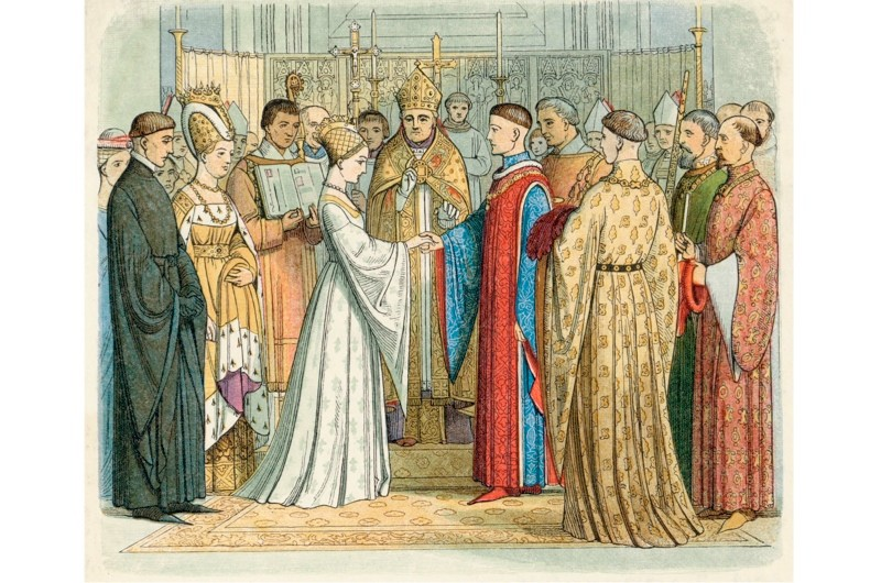 Catherine de Valois is seen here marrying Henry V, who was 14 years her senior, as part of the 1420 Treaty of Troyes. Following Henry's death she wed Welshman Owain ap Maredudd ap Tudur, who is variously referred to as the queen's steward, page or cupbearer. (Mary Evans Picture Library/Alamy)