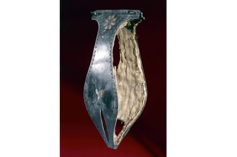 Chastity belt decorated with a flower design and a heart pierced with arrows. (SSPL/Getty Images)
