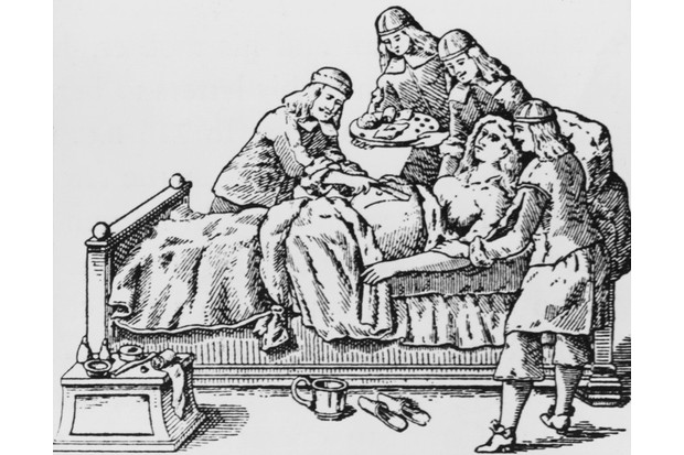 Doctors perform a caesarean section, circa 1650. Woodcut from the works of 17th Century surgeon Johann Schultes. (Photo by Hulton Archive/Getty Images)