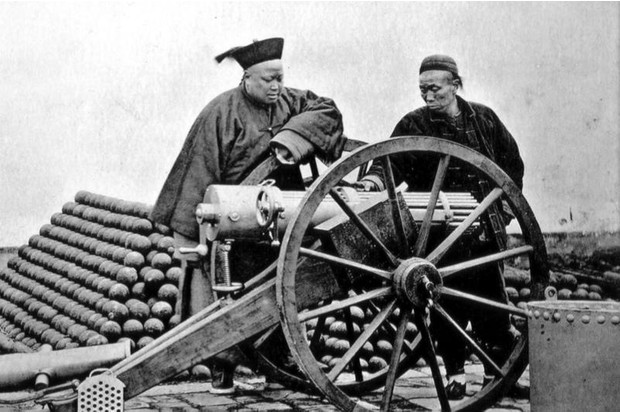An Imperial Army officer inspects one of the US-made Gatling guns imported into China in the late 19th century