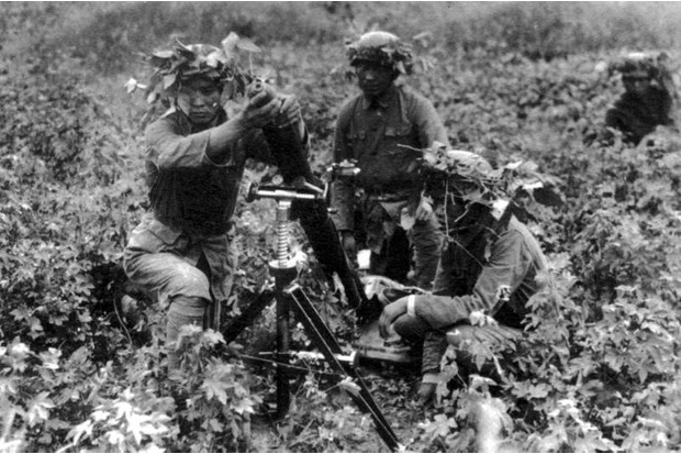 A 81mm mortar crew lay down covering fire during a Nationalist counter-attack in the fighting of 1938