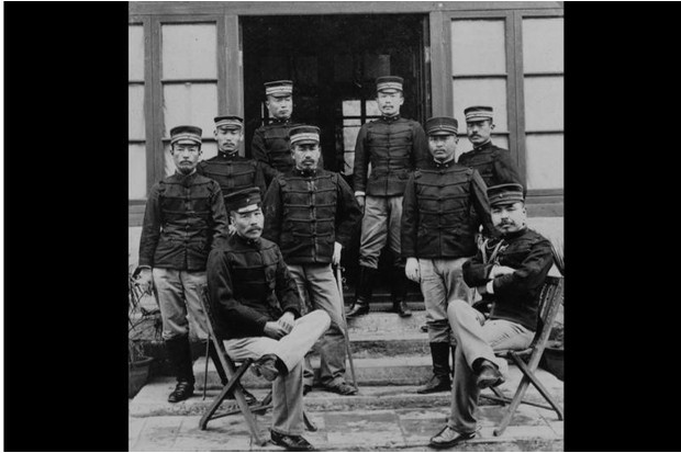 Japanese officers rest outside their headquarters in Peking after the takeover of the city on 14 August 1900