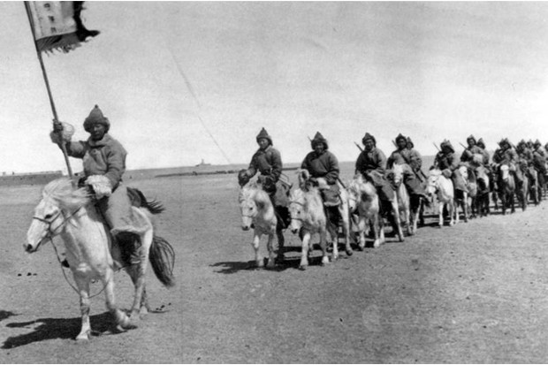 A unit of Inner Mongolian Prince Teh Wang's 'elite' cavalry rides past during a parade in 1935