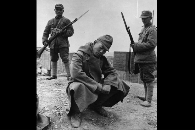 The rare sight of a Japanese prisoner of war is captured on film for the Western press