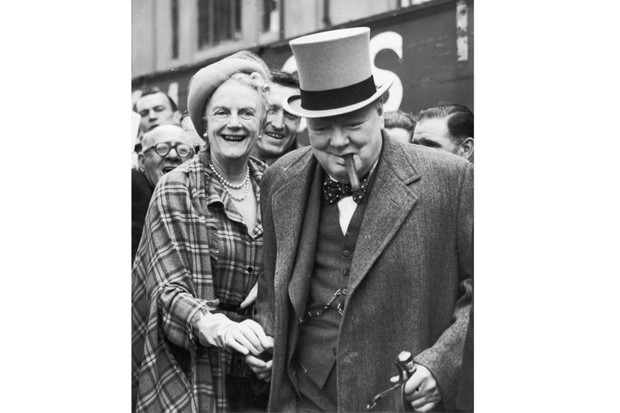 1949: Clementine with husband Winston Churchill at Epsom racecourse for the Derby. (Central Press/Hulton Archive/Getty Images)