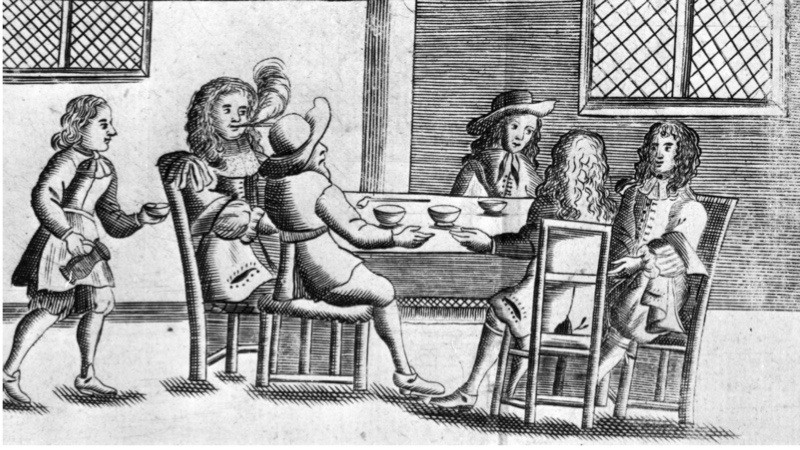 1674, Men enjoying a drink and a chat in a 17th century coffee shop. (Photo by Hulton Archive/Getty Images)