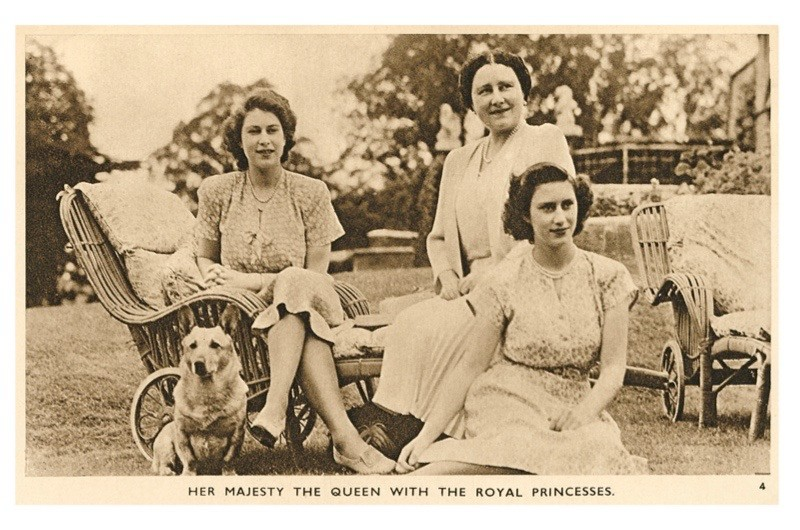Vintage postcard showing Princess Margaret and Princess Elizabeth with Queen Elizabeth the Queen Mother and a pet corgi. (Photo by the History Press)
