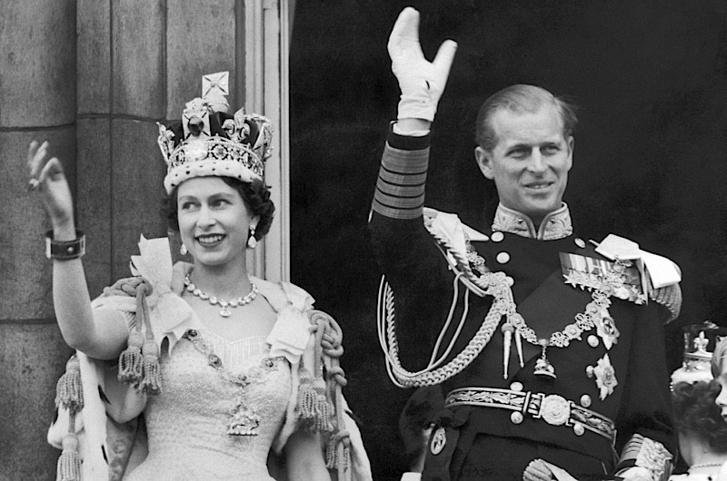 Queen Elizabeth and the Duke of Edinburgh wave from the famous balcony at Buckingham Palace after the Queen's coronation on 2 June 1953. (Keystone-France/Gamma-Keystone via Getty Images)