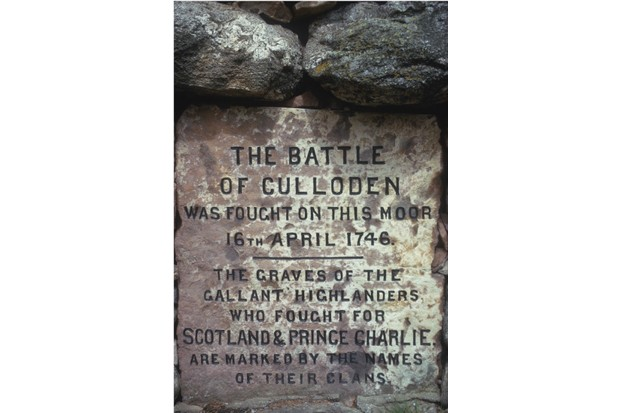A stone memorial marking where the battle of Culloden took place. (RDImages/Epics/Getty Images)