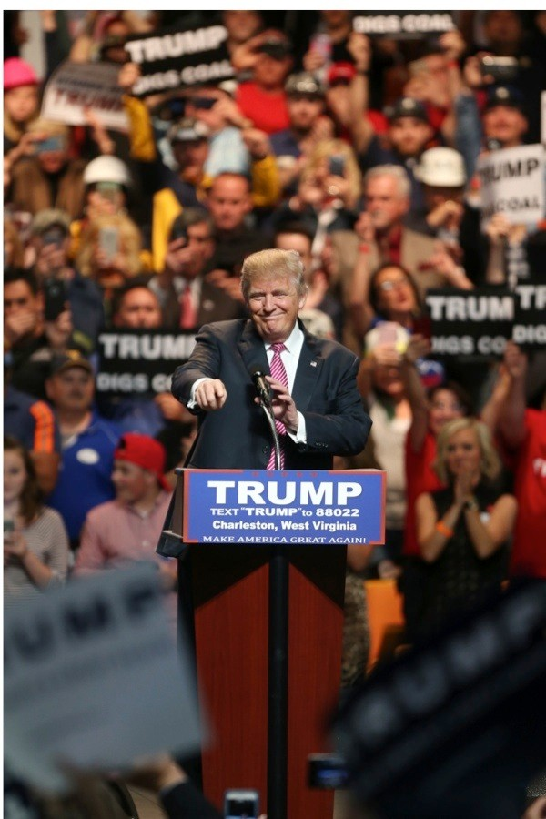 CHARLESTON, WV - MAY 05: Republican Presidential candidate Donald Trump points to his supporters as he arrives for his rally  at the Charleston Civic Center on May 5, 2016 in Charleston, West Virginia. Trump became the Republican presumptive nominee following his landslide win in indiana on Tuesday.(Photo by Mark Lyons/Getty Images)