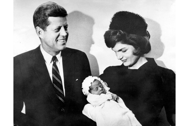 <em>President Kennedy and his wife, Jackie, after the christening of their son John Fitzgerald Kennedy Jr in 1960. (© Keystone Pictures USA/Alamy)</em>