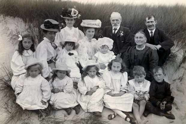 Photo of an Edwardian family on sand dunes
